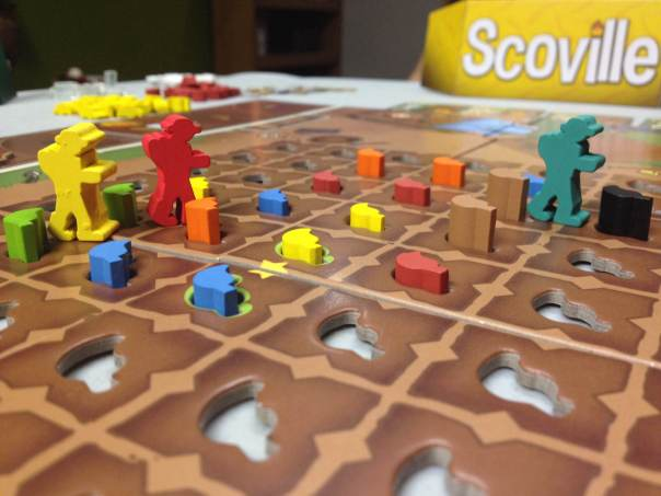 The Yellow and Red player are mired in battle for the peppers in that part of the board.